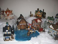 """Going to try this bloggers idea: to use a blue plastic bag under a pane of glass to make """"water for my light house! From: Adirondack View...: Christmas Village,...and More!"""