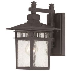 Illuminate your patio or three-season porch in chic style with this eye-catching wall lantern, featuring a black finish and seeded glass panels.