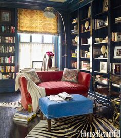 Red, white, and blue gets a bohemian twist in the library with lacquered walls, a silver ceiling, and ethnic textiles.