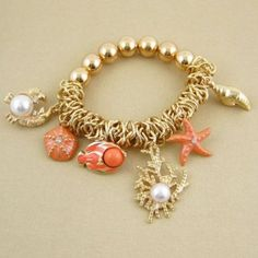 love the color combo - gold, coral and pearls