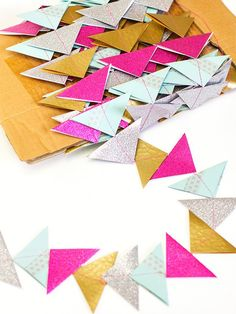 Pin for Later: 17 DIYs For a Quirky-Cool Wedding Filled With Color Paper Triangle Garland Add some fun geometric elements to a Spring or Summer wedding with this paper triangle garland.