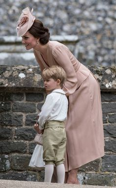 Catherine Duchess of Cambridge and Prince George of Cambridge attend the wedding of Pippa Middleton and James Matthews at St Mark's Church on May 20...