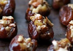 Dates stuffed with ginger and almonds. I think I'd dip the bottom half in chocolate.