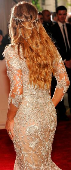 Love that dress and the hair piece