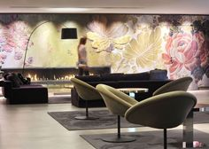 Commercial Interiors. Hotel Sofitel Bellacour in Lyon, France. Woven silk tapestry. Pierre Paulin chairs.  Designer: Studio Norguet.