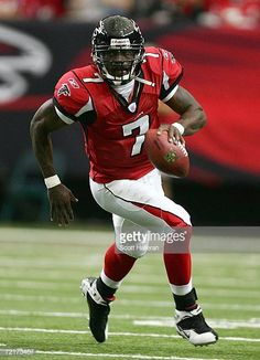 Michael Vick of the Atlanta Falcons runs upfield during their game against the New York Giants on October 15 2006 at the Georgia Dome in Atlanta. Atlanta Falcons Team, Falcons Football, Nfl Football Teams, Falcons Players, Football Stuff, School Football, Football Pictures, Sports Pictures, Mike Vick
