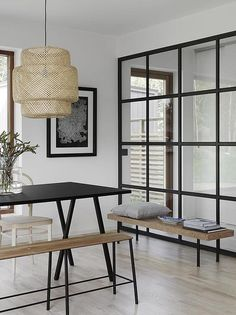 Minimalist Monochrome Dining Room with Cork Accents - Dining Room Decorating Ideas