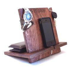 Handcrafted from real wood, this docking station will hold all of his everyday essentials. You can add your own personalized, laser engraved message too!