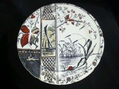 """Aesthetic movement transferware 10.5"""" dinner plate in Osborne pattern.  Black transfer enhanced by gold and red handpainted color under the glaze.  Made by J.H. Davis Potteries, Staffordshire,England. Displays Victorian love of the exotic and Oriental."""