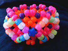 Neon Star Simple Glow in the Dark 3D Cuff Rave Kandi Cuff. $6.00, via Etsy.