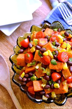 Tex Mex Roasted Sweet Potato Salad ... a delicious vegetarian side dish recipe your family will love! This cold roasted sweet potato salad is packed with healthy, fresh ingredients: black beans, corn, tomatoes, and cilantro ... all tossed together with an amazing chili lime vinaigrette (with a touch of maple syrup). It's also gluten free and vegan, and makes a tasty side or even a light dinner or lunch!   Hello Little Home