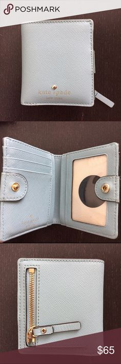 Kate Spade Small Wallet Light blue and in excellent condition. Compact and very functional wallet in saffiano leather.  Snap closure with outside coin compartment. kate spade Bags Wallets