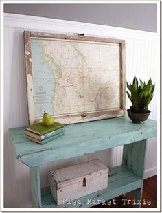 Salvaged Window - used as a frame for a large map.  This post has a tutorial on how to decoupage the map to the window - via Flea Market Trixie
