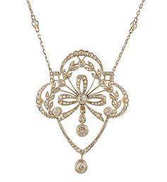 An Edwardian diamond pendant with laurel leaf and bow decoration, in platinum and gold. Atw 1.53 Cts.          Circa:    1910