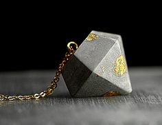 This diamond shaped pendant is made of concrete and gold flakes. Actually I use…