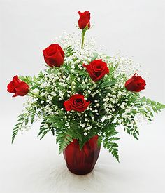 Romeo Six-Six beautiful fresh long stem Red Roses accented with baby's breath and a red heart.