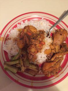 Chicken stew with veggies. White rice and fried zucchini