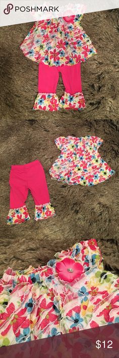 """Pink ruffled top and legging set. Hot pink and floral ruffled top. Ruffled leggings make this outfit a set. New without tags. Never worn. 12 months. Length of top: 12"""". Length of leggings: 13"""". Waist: 7"""". Little Lass Matching Sets"""