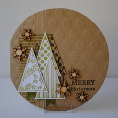 handmade Christmas card ... circle shape .. kraft ... like the grouping of mod triangle trees ... sprinkling of wood snowflakes ... fun card!!