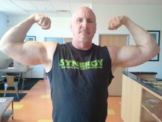 a balding hot silverdaddie muscleman flexing huge thick bicep arms