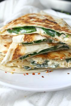 Two favorite snacks are combined into one with these Vegan Spinach Artichoke Quesadillas. These are ooey, gooey and super delicious.