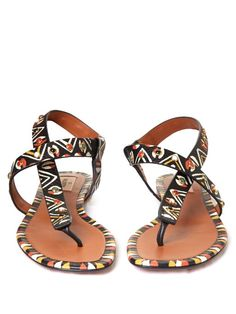 Valentino's leather thong sandals are a starting point for the season's global traveller looks. Each pair is hand-painted with a rich mix of tribal motifs and studded with multicoloured stones. Slip them on with one of the house's printed maxi dresses for full effect.