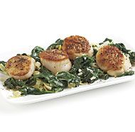 Seared Scallops with Creamy Spinach and Leeks--Sweet leeks and rich cream mellow the slightly bitter edge of sautéed fresh spinach. Together, they make a luscious bed for seared scallops. Leek Recipes, Fish Recipes, Seafood Recipes, Gourmet Recipes, Healthy Recipes, Cooking Recipes, Healthy Foods, Recipies, Seafood Buffet