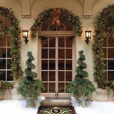 "Park Avenue Topiary 6 ft ~ $399 Frontgate. Lifelike evergreen boughs are festooned with 300 clear lights, adding a sparkling holiday touch. The 6 ft. columnar piece rests inside a cascading 30"" diameter wreath that rests on any planter. Can be left out year round. Made of durable and weather-resistant plastics ..."