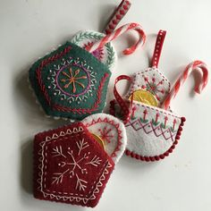 This is my design for Christmas 2016. These little pockets can be made up very quickly and easily and can be used to hang on the tree filled with chocolate coins or candy canes or small gifts, or make an advent calendar with one pocket for every day leading up to Christmas day. I have provided the numerals in the pdf so you can try this idea too ... Finished pocket size is approximately 12 x 10 cms, but it can be reduced or enlarged.  This PDF contains:  1. Patterns for three pockets 2…