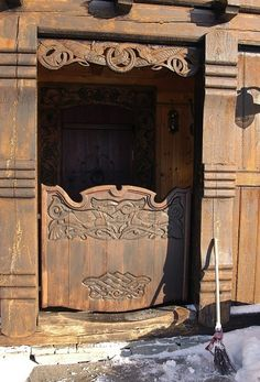 Wonderful hand carved doors in Viking pattern at Faavang in Oppland County, Norway.