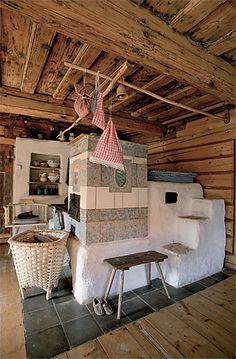 cottage  with old wood ceiling and oven