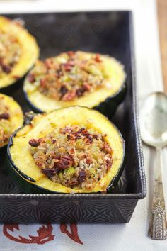 Stuffed acorn squash makes for an easy weeknight meal. It's easy to prepare and you can create numerous variations depending on the additional produce you have on hand.