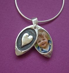 This lovely heart design holds up to TWO photographs of a loved one. It is larger than the other heart lockets I have here listed in my shop- the same size as the Tree of Life or Flower lockets. This is a perfect Mothers day or Christmas gift for a new mother, grandmother, sister, daughter, special friend, baby christening gift etc. The locket is a peek-a-boo style which means it swings open to reveal the photos inside. It is made from sterling silver and measures approximately 18 mm high…
