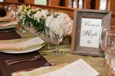Long wooden boxes adorned banquet style tables on the balcony.  Chocolate linens with satin green runners added warmth.  Each table was named after a flavor of coffee for these coffee lovers!  Florals by Beautiful Flowers by June. Dana Laymon Photography