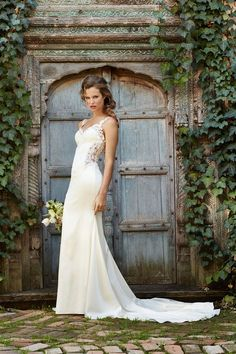 Willowby by Watters - Cora. Beautifully crafted in Beaded Lace and Stretch Satin, this fit-and-flare gown has a modified sweetheart neckline and lace straps. On the back, Beaded Lace placed on Illusion Tulle complete the look for added impact on the big day. Chapel train.