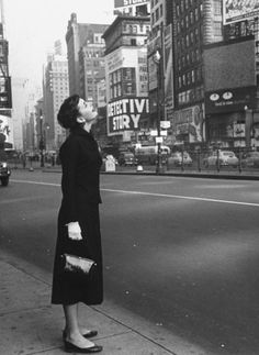 Audrey Hepburn looks up at Times Square in 1951