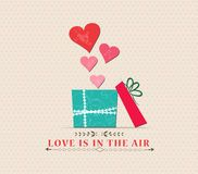 Valentine's Day love is in the air with open gift Royalty Free Stock Photography