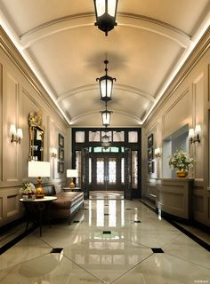 Crisp Black and Tan with gold accent and traditional light fixtures