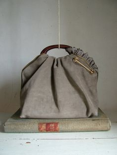 from Etsy site ~ this is adorable and so different, just by gathering a fold for the handle placement. Inspiration