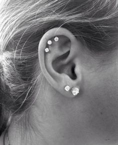 Double lobe, triple cartilage piercings. Love it