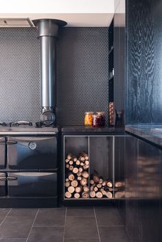 The kitchen features a Donard wood-fired stove by Stanley and tiles from Classic Ceramics.