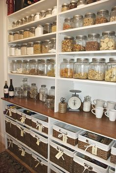 Organized pantry - using clear glass jars, vintage mason jars & lined baskets.