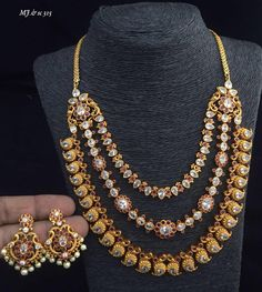 Beautiful one gram gold triple layer necklace;. forst layer with mango hangings. Necklace studded with white color kundans. 15 February 2018