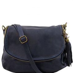 Deze donkerblauwe lederen schoudertas heeft een vak aan de achterkant met ritssluiting. Overslag Van binnen heeft de tas 1 compartiment, 1 vak met rits en 1 vak voor uw smartphone. - € 86,99
