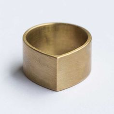white bronze + brass ring - could add a single gemstone to one side, just past the peak, for a cool engagement ring... :)