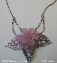 Beadwork necklace with Russian leaves and acrylic flowers