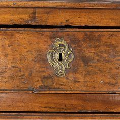 A Louis XV Provincial walnut bombe commode, mid 18th century. Serpentine top above undulating drawer fronts with snail scroll ornamentation on a conforming apron above scrolled cabriole feet, Circa 1750. height: 34 in. 86 cm., width: 49 in. 124.5 cm., depth: 23 in. 58.5 cm. #rocaille #louisxv #frenchprovincial #louisxvfurniture #commode #vintagecommode #frenchantiques #sf #sanfrancisco #cscroll #escutcheon #vintagehardware #interiordesign #designanddecoration #keyhole