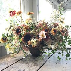 Early September in a vase. Bouquet includes: Rosehips, Rudbeckia 'Sahara', Sunflower 'Sparky', Phlox 'Cherry Caramel', Nicotianna 'Tinkerbelle', Hydrangea 'Limelight', Broomcorn, Honeysuckle 'Scentscation', Clematis, Rose 'Snow Goose' and 'Sally Holmes', Heuchera 'Palace Purple' and Echinacea.