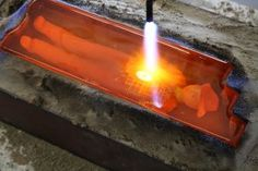 """Trenchard torching a 12 x 4 x 4.5"" hot sand casting with handprinted & sculpted glass cowboy"" by Stephanie Trenchard"