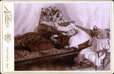 Girl on a couch accompanied by her favorite doll
